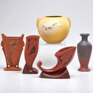 Roseville etc five pieces zanesville oh first half of 20th c roseville yellow ixia spherical vase red silhouette cornucopia and vase teasel vase together with pink and grey glazed vase all