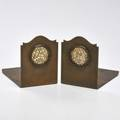 Potter studio pair of copper bookends with carved jade insets first quarter 20th c both marked potter studio each 5 14 x 4 x 7
