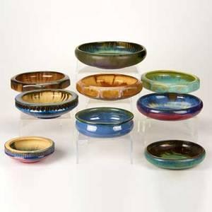 Fulper nine low bowls flemington nj ca 19101928 including three tensided two with greek key design etc glazed earthenware all marked largest 11 dia