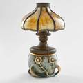 Riessner  kessel amphora vase decorated with peacock feathers fitted as a lamp with a slag glass shade turnteplitz bohemia 190510 stamped amphora 453588 with shade 13 12 x 7 14 dia