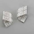 Piaget diamond 18k white gold stardust earrings designed as ribbons 80 bead set round brilliant cut diamonds approx 3 cts tw ca 2005 left and right b65374 signed clip backs for pierced ea