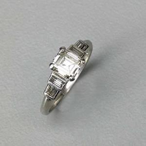 Art deco diamond platinum engagement ring asscher cut diamond 529 x 610 x 320 mm 84 ct by formula and baguette cut diamond shoulders marked 10 ir pt size 7 250 dwt