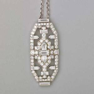 Art deco diamond platinum brooch  necklace geometric brooch panel with oec baguette cut and calf cut diamonds approx 40 cts tw suspends from later 14k wg chain revised 1 34 x 34 16