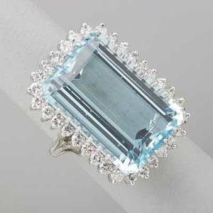 Aquamarine and diamond 14k white gold ring emerald cut aquamarine 27 cts by formula framed by 32 full brilliant cut diamonds approx 1 cts tw ca 1960 size 6 109 dwt