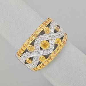Yellow and colorless diamond bicolor 18k gold band open ribbon set with bright yellow and white diamonds approx 1 cts tw ca 1995 size 8 9 dwt