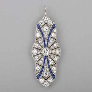 Art deco diamond and sapphire platinum pendant geometric open design centers oec diamond approx 50 ct bead set smaller diamonds and calibre cut sapphire channels ca 1920 approx 288 cts tw