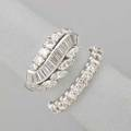 Two diamond rings twentyfive stone diamond eternity band approx 12 cts size 8 platinum dress ring ribbons of circular baguette and marquise cut diamonds approx 150 cts tw size 7 ca 19