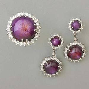 Purple star sapphire and diamond ring and earrings 14k wg ring features large round cabochon cut star ruby surrounded by full cut diamonds sz 6 1 12 companion drop earrings five rubies weigh 7