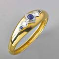 Diamond and sapphire 18k gold hinged bracelet two transitional cut diamonds approx 21 cts tw flank a circular cut sapphire approx 175 cts enhanced by smaller diamonds and sapphires 2 114