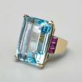 4944 cts aquamarine and ruby ring emerald cut aquamarine of good color 2562 x 1880 x 1358 mm six calibre cut rubies in channel shoulders 14k yg ca 1942 size 7 12 149 dwt provenance