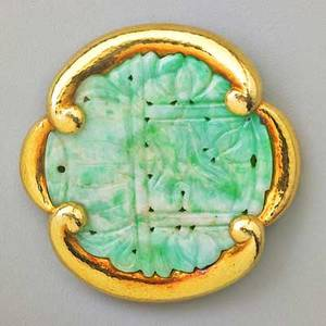 David webb large jade and 18k gold pendantbrooch round mottled jade disk pierced and carved in the asian style in hammered 18k gold frame ca 1980 hinged double pin back and hinged bail marked o