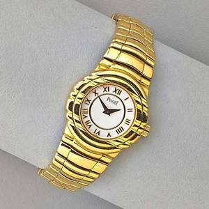 Piaget tanagara ladies 18k gold bracelet watch quartz movement white dial with gold roman hours 25 mm solid case and heavy link bracelet with deployment buckle case 16031m401d 583067 8 557