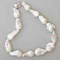 Baroque white south sea pearl necklace thirteen asymmetric cometshaped pearls 4028 mmbrushed sterling clasp 18