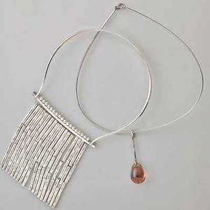Two danish modern silver necklaces amethyst glass cabochon pendant on wire vivianna torun bulowhube france 1954 retailed by georg jensen inc 2 12 hans hansen bamboo fringe necklace 355