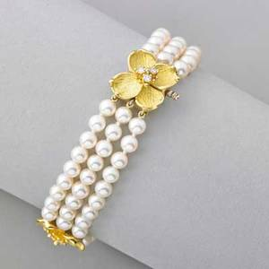 Tiffany  co pearl and diamond dogwood bracelet triple strand cultured saltwater pearls 5  45 mm and three textured blossoms with diamond clusters one conceals clasp 18k gold 1990s marked t