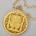 Aztec sun god pendantbrooch and chain 18k gold circular pierced and incised brooch center the sun god huitzilopochtli glyph incised reverse ca 1980 hinged bail 1 1516 diameter on 31 12 cha