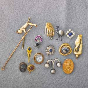 Fourteen gold or silver stick pins gold mechanical climbing monkey stick pin 4 ivory on gold bust of venus 14k yg hand holds white gold and diamond jewelers loupe art deco black diamond appro