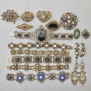 Renaissance revival silver jewelry collection 18 items with enamel pearls onyx citrine amethyst beryl or garnets etc six link bracelets two pairs of earrings six brooches clip onyx pendan