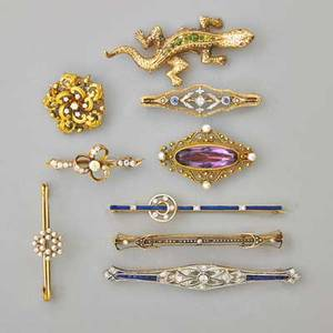 Nine antique jeweled gold brooches tiffany  co enameled 18k gold bar pin with diamonds demantoid garnet and 14k gold salamander with ruby eyes sapphire and diamond platinum bar pin oec diamond 1