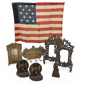 Military interest items eight pieces american  european 19th20th c include pair of cast iron eagle bookends wwi us cast iron picture frame and hook pair of patinated white metal frames with