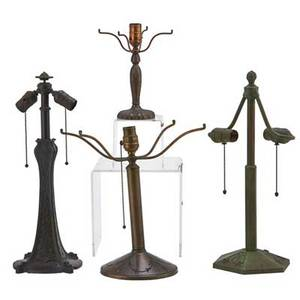 Bradley  hubbardpairpoint four metal lamp bases early 20th c three bradley  hubbard and one pairpoint tallest 20