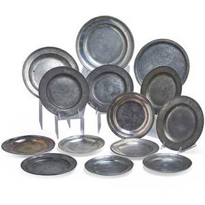 Continental pewter plates fourteen 18th19th c one etched with sailing ship one dated 1803 largest 12 12 dia