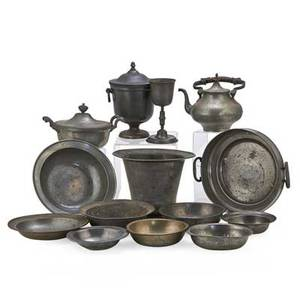 Continental pewter fourteen items18th19th c chalice tea kettle two covered serving pieces flower pot and eight bowls tallest 11