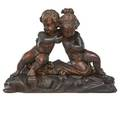 Continental carved wood sculpture walnut with cherubs standing on a rock early 20th c 15 x 20 12 x 7