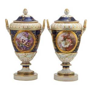 Pair of kpm porcelain urns handpainted with genre scenes in reserves on cobalt ground with gilded trim 19th c stamped kpm 20