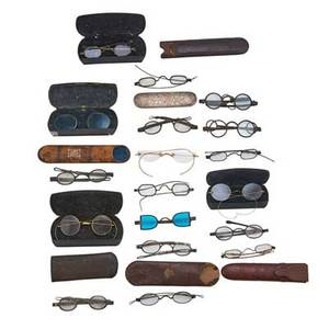 Assorted eyeglasses eighteen pair in various sizes and shapes most with cases 19th20th c largest 7