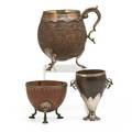 Silver mounted coconut shells three items 19th c handled footed mug and two cups tallest 5 12