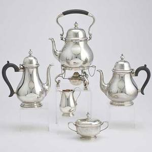 Tiffany  co silver coffee and tea service five piece queen anne pattern service pearshaped with ebony handles ca 1965 kettle on stand with burner 14 coffee pot 10 teapot 8 34 cream