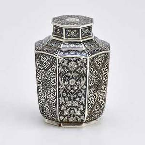 Antip kuzmichev for tiffany  co tea caddy silver and niello tea caddy with tapered octagonal vessel with doublelobed shoulders and octagonal cap intricate decorations of foliage and interlaced ar
