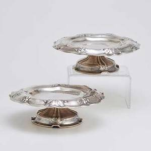 Pair of gorham martele silver compotes spothammered with primrose raised and chased on everted undulating rim and dome foot 1909 leafy monogram m w under foot both marked martele 9584 ryp 9