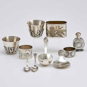 Homeric arts and crafts and other american silver ten pieces tiffany  co sagamore flask mount with bicolored gold patinated etched decorations duhme  co homeric caddy spoon shreve 14th c