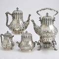 Tiffany  co sterling coffee service four pearshaped vessels with floral and acanthus chasing fluted collars and lids ivory insulators rusticated branch handles and leaf spout includes kettle o