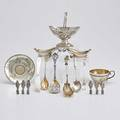 Seventeen pieces of american ornamental silver tiffany  co engraved and parcel gilt sterling cup and saucer 1888 tiffany young  ellis swinghandled oval sugar bowl with floral repousse 184518
