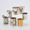 Seven american silver mugs and cups octagonal shape by r  w wilson philadelphia 18251846 plain gilt silver by jones shreve brown  co boston 18551860 marked pure coin silver handled mug