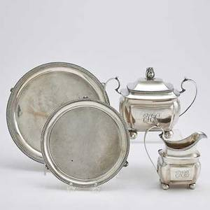 American coin silver holloware 19th c four pieces two piece cushionshaped cream and sugar service henry lewis philadelphia ca 1811 bowl 8 12 across handle salver with laurel border insc