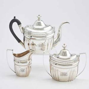 Sayre  richards american coin silver tea service three pieces adams style with vertical fluting bright cut ornaments and urn finials teapot with ebony handle and gooseneck spout 7 12 x 12 14