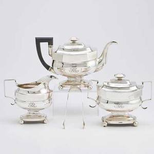 H wishart american coin silver tea service three vessels in the empire style on ball feet includes teapot with gooseneck spout and ebonized handle 11 12 covered sugar urn with associated tongs