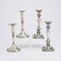 Two pairs of antique silver candlesticks pair of weighted floral repousse candle stands unmarked 11 12 pair of raised and forged with applied cast or punched bead edges chiseled linenlike deta