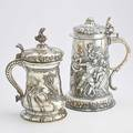 Two massive decorative silver plated tankards electroplated copper embossed with battle scene and vegetal borders 14 electroplated brass in the german style with twisted flute and rocquille decora
