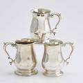 Three english sterling mugs with scroll handles william gould london 1762 william shaw and william priest london 1752 illegible maker mark london 1758 all 5 3841 ot