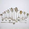 English and continental silver spoons and tongs fifty four pieces two berry spoons with gilt fruit motif bowls jas wilkes london 1742 8 seven marrow spoons paul hanet london 1725 london