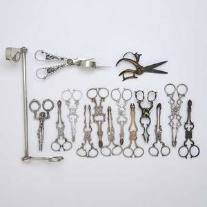 Candle snuffers wick scissors and sugar tongs fifteen pieces old sheffield plate wick snuffer ca 1770 9 34 800 silver candle snuffer depicting clown with snakes naumburg germany 18th c 4