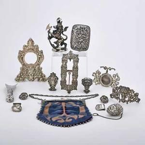 Americancontinental ornamental silver accessories fourteen pieces gorham art nouveau handbag with resistdyed velvet sack 8 14 floral repousse soap box cartelshaped pocket watch frame b3177