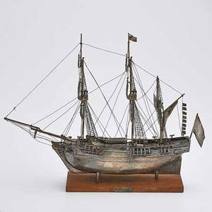 Silver ship replica hms bounty rigged with furled sails on wood base unmarked 12 x 15 34