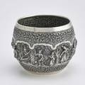 Large thaiburmese repousse silver bowl bulbous form densely chased with nobles and deities in landscape bordered by chased bands of leafy scroll 19th c 7 x 8 12 3925 ot