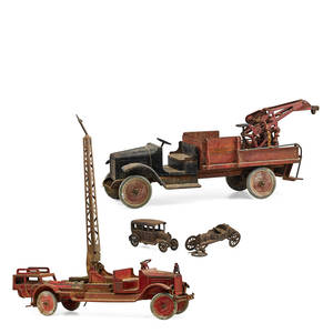 American steel toy trucks four two large buddy l water steel fire trucks together with two small cast iron trucks early 20th c largest 35 x 34 x 9